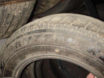 Зимние шины Brigestone 195/65 15 дюймов б/у в Уссурийске