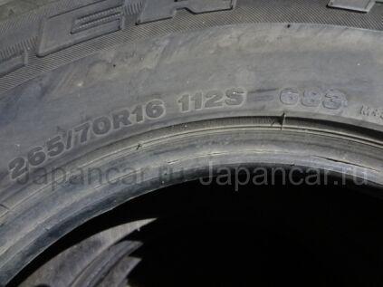 Всесезонные шины Bridgestone Dueler h/l 265/70 16112 дюймов б/у в Артеме