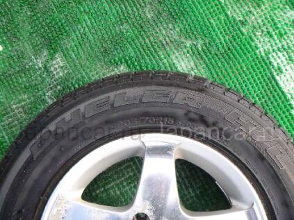 Летниe шины Bridgestone Dueler h/l 205/70 15 дюймов б/у во Владивостоке
