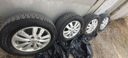 Всесезонные колеса 195/65 15 дюймов Nissan б/у во Владивостоке