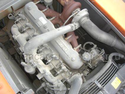Экскаватор колесный Hitachi ZX125W-6125 2004 года в Японии
