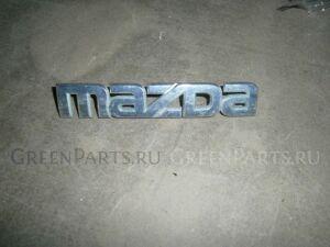 Эмблема на Mazda Demio