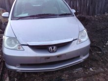 Амортизатор HONDA FIT ARIA GD9 L15A