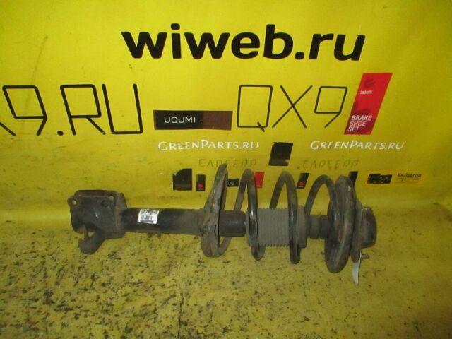 Стойка амортизатора на Mitsubishi Pajero IO H76W 4G93