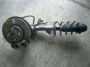 Стойка амортизатора на Toyota Ractis SCP100 2SZ-FE