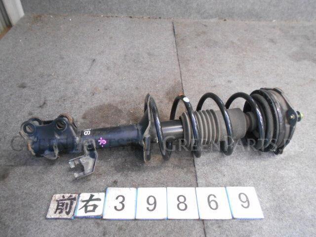 Стойка амортизатора на Nissan Tiida JC11 MR18DE