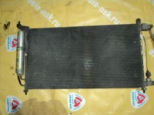 Радиатор кондиционера на Nissan Tiida C11