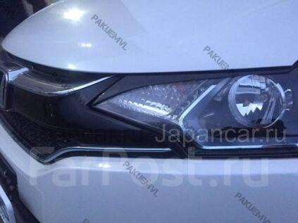 Накладки на фары на Honda Fit во Владивостоке