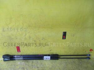 Амортизатор двери на Nissan X-Trail TNT31