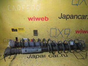 Амортизатор на Mazda Verisa DC5W